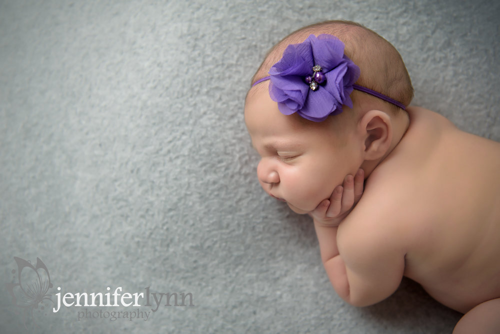Newborng Girl Purple Grey Hand on Cheek
