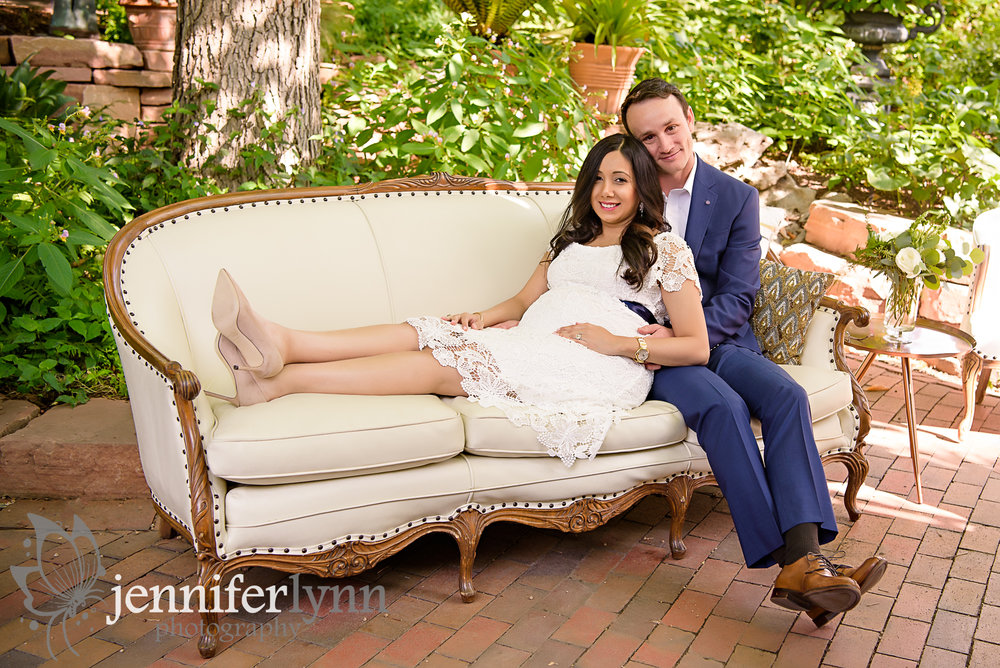 Maternity Couple on Vintage Couch Gardens