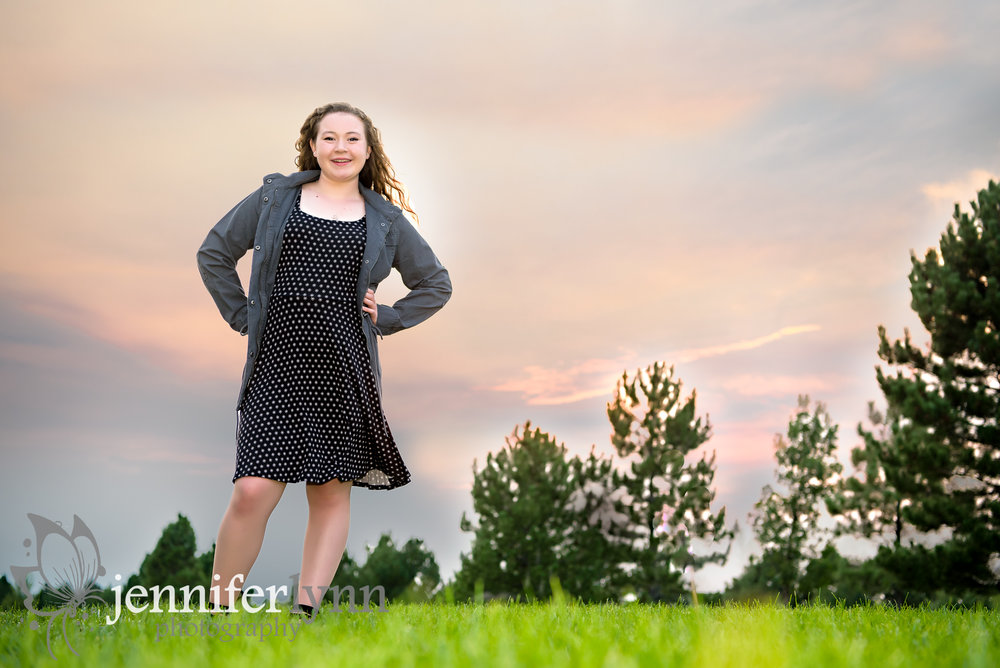 Senior Girl Stands Hill Pink Sunset