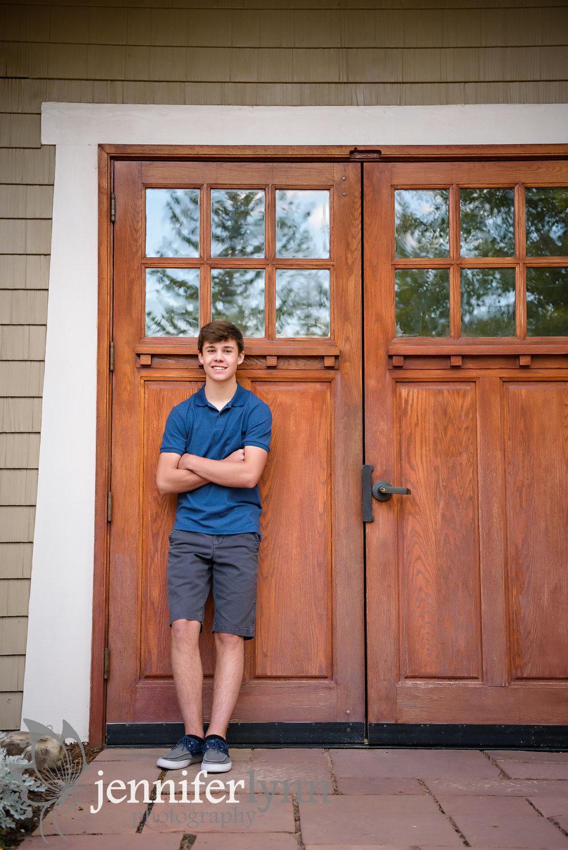 Senior Boy Rustic Wooden Door Leaning