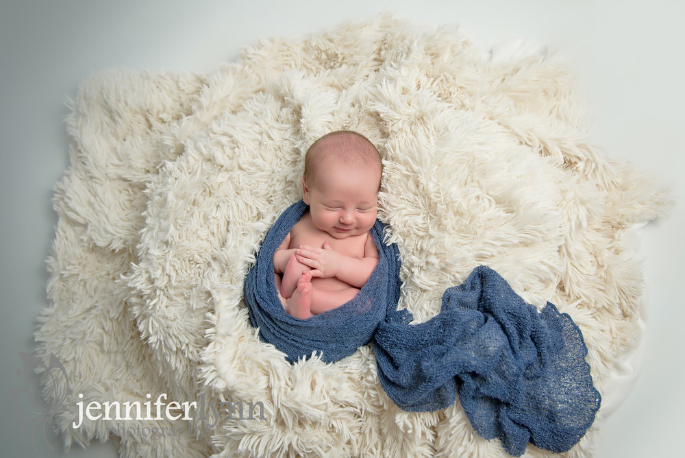 Newborn Boy Smile White Fur Blue Wrap