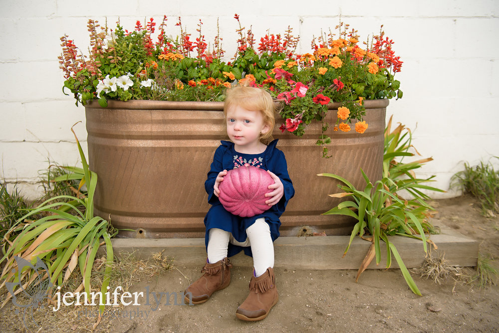 Girl Sitting Fall Flower Display Pumpkin