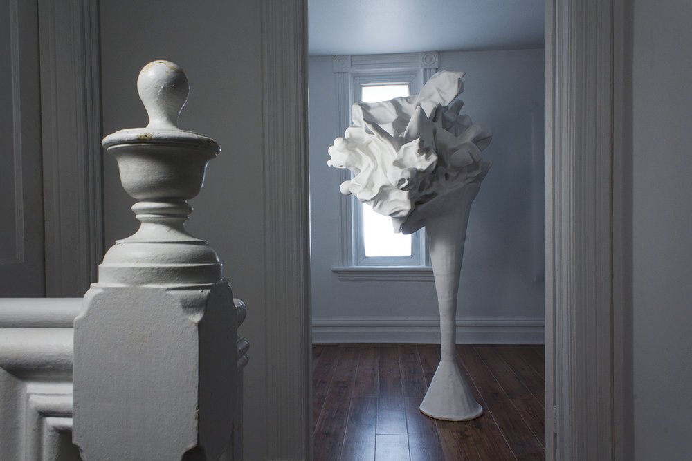 Bouquet , 2015, plaster, cement, plastic flowers, wicker frame (shot in situ)
