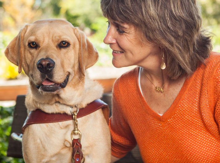 Becky Andrews and her third guide dog, Georgie. Becky's dogs have helped the Utah mom raise two kids, start a business with her husband, and train for marathons. Photo courtesy of Guide Dogs for the Blind.