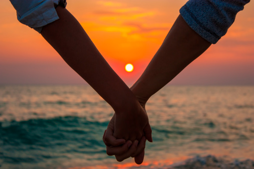 couple-holding-hands-sunset150685331pc.jpg