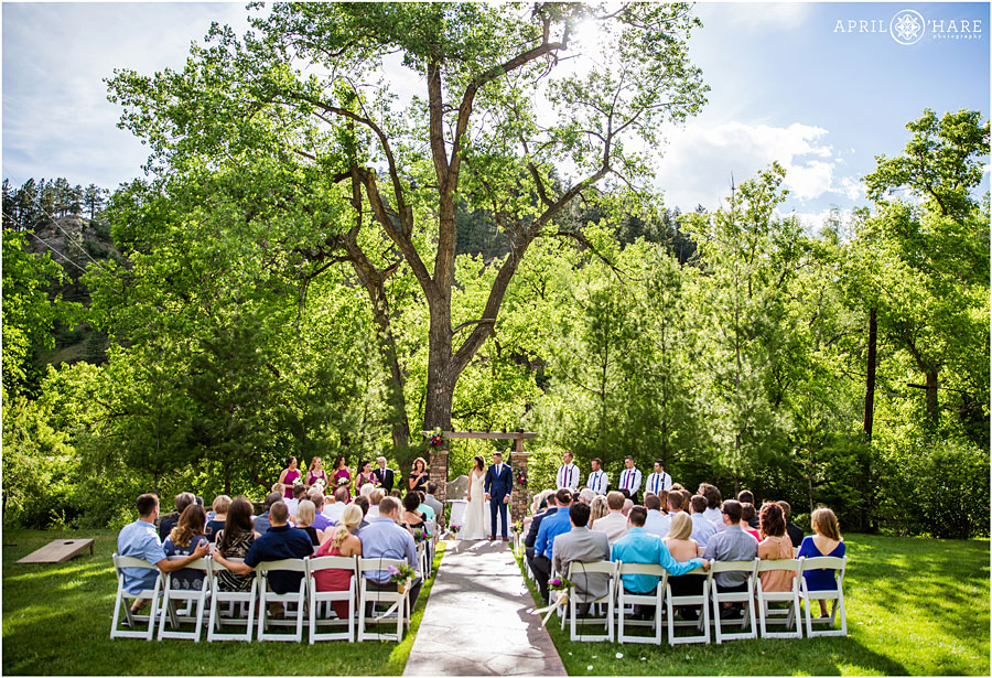 Pretty-CO-sunny-wedding-day-underneath-trees-at-Wedgewood-on-Boulder-Creek.jpg