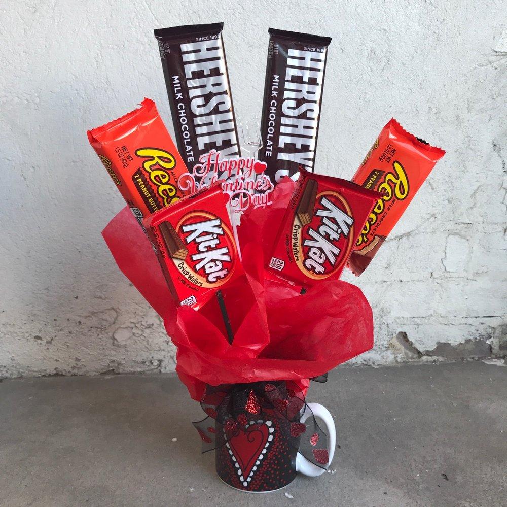 Candy Bouquet in Mug, glass cube or plastic container   Small (shown) $20.00  Medium $25  Large $30.00  * mug design varies
