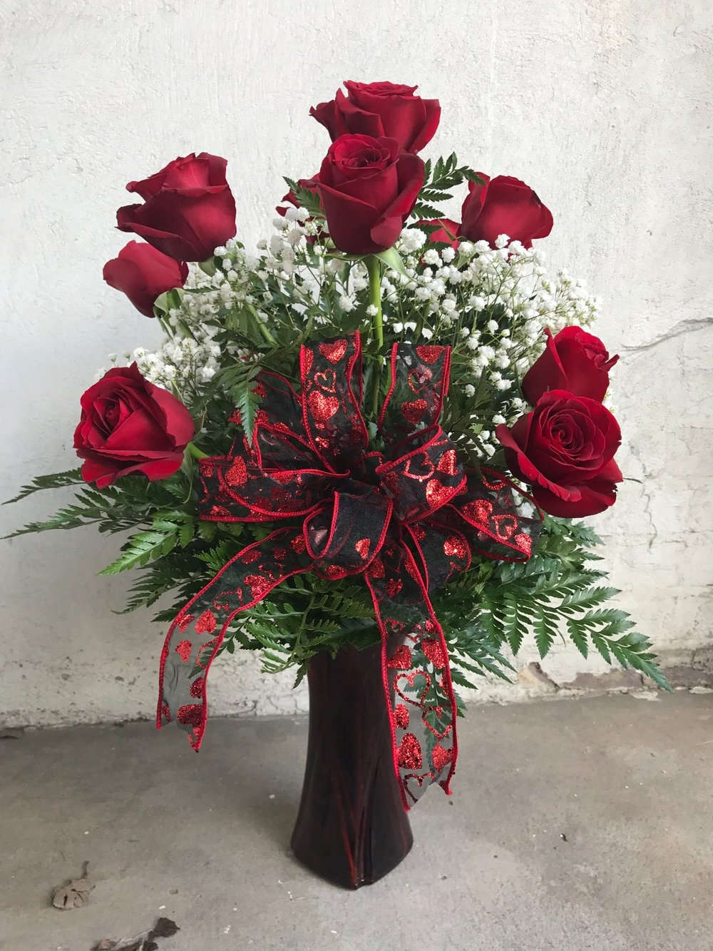 Traditional Dozen Red Roses   Features 12 long stemmed red roses with babies breath. $84.95  Add a valentines bear or box of chocolates for the perfect gift