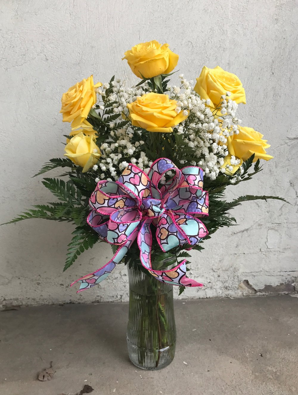 Colored Dozen Roses   Features 12 long stemmed roses with babies breath. $72.50  We have several color choices available.  Add a valentines bear or box of chocolates for the perfect gift.