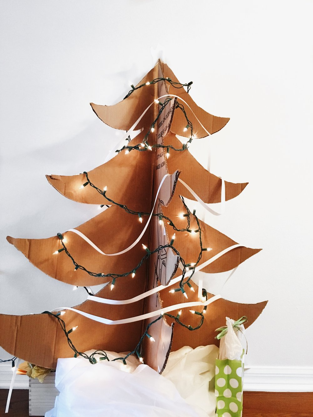 My eco-friendly cardboard Christmas tree. Made and decorated with used furniture packaging.