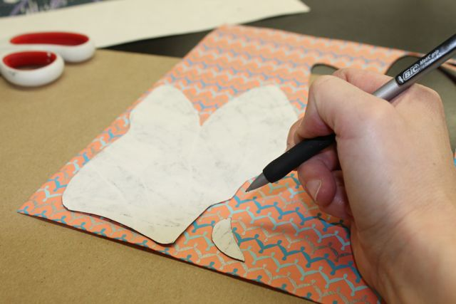 Use the cut-out to trace the shape. into the chosen paper