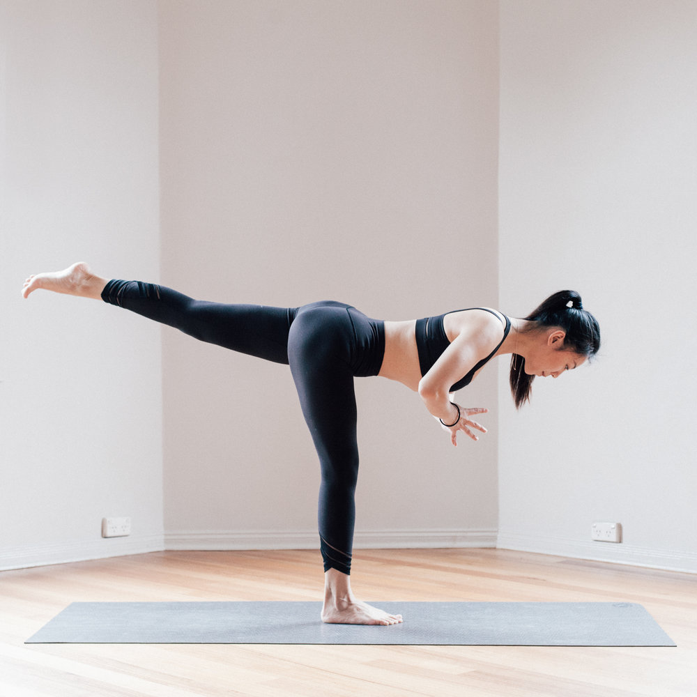 Jowing Zhang in a Yoga Balancing Pose at Little Mandarin Yoga Studio