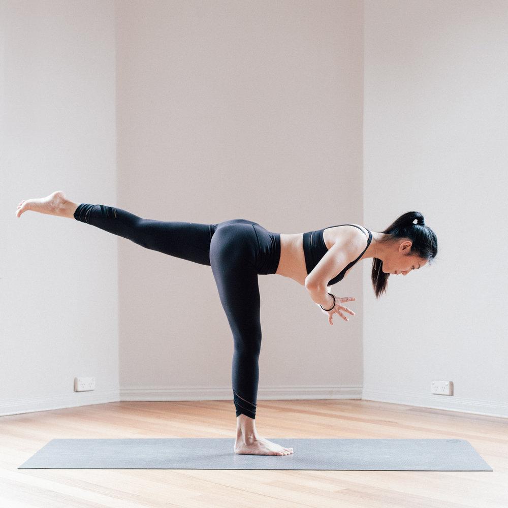 Jowing Zhang in a Yoga Balancing Pose at Little Mandarin Yoga Studio
