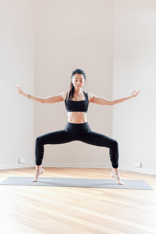 Jowing Zhang in a Yoga Balancing Pose Goddess Pose at Little Mandarin