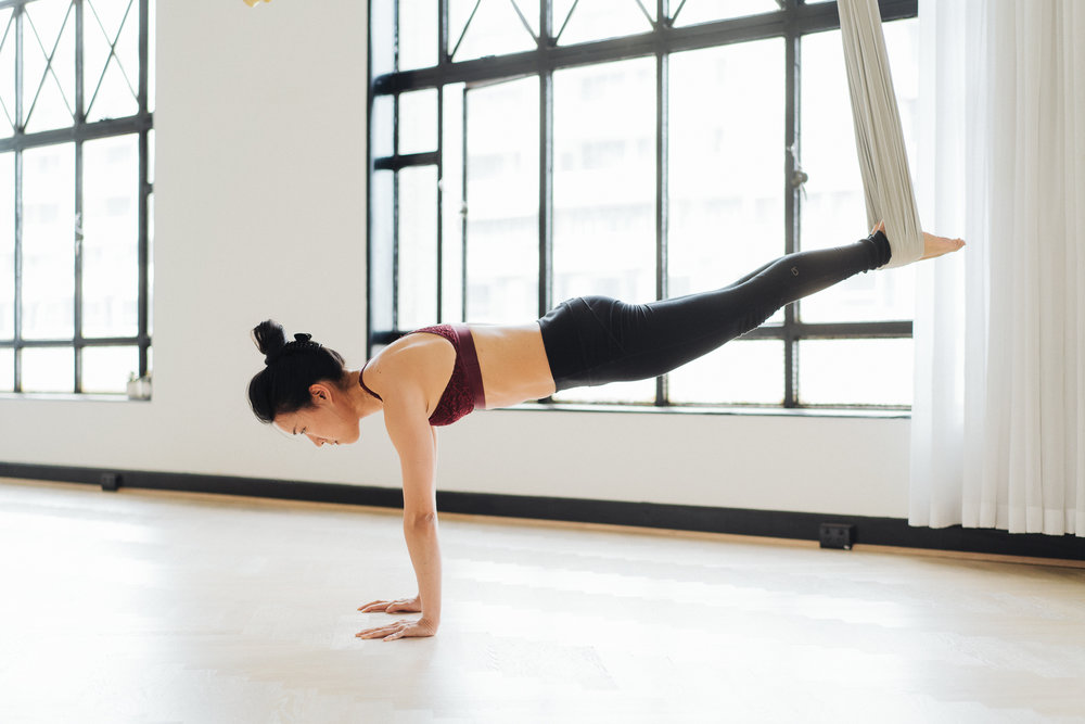 Plank pose - legs suspended in the air optional!