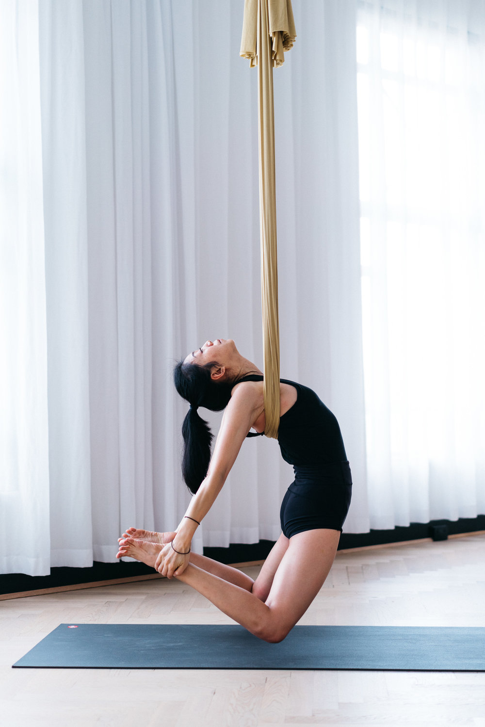 Figure 6(b) : Supported camel pose using gravity to help you lengthen your spine instead of dumping into lower back