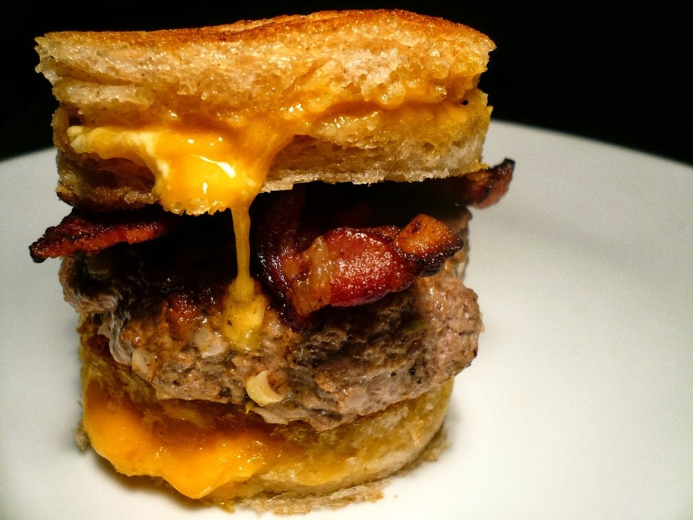 sourdough grilled cheese sandwich burger with bacon and tomato