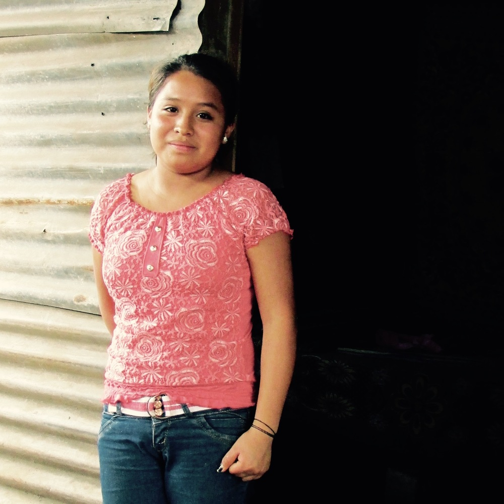 Francisca, one of the children, in front of the former shelter