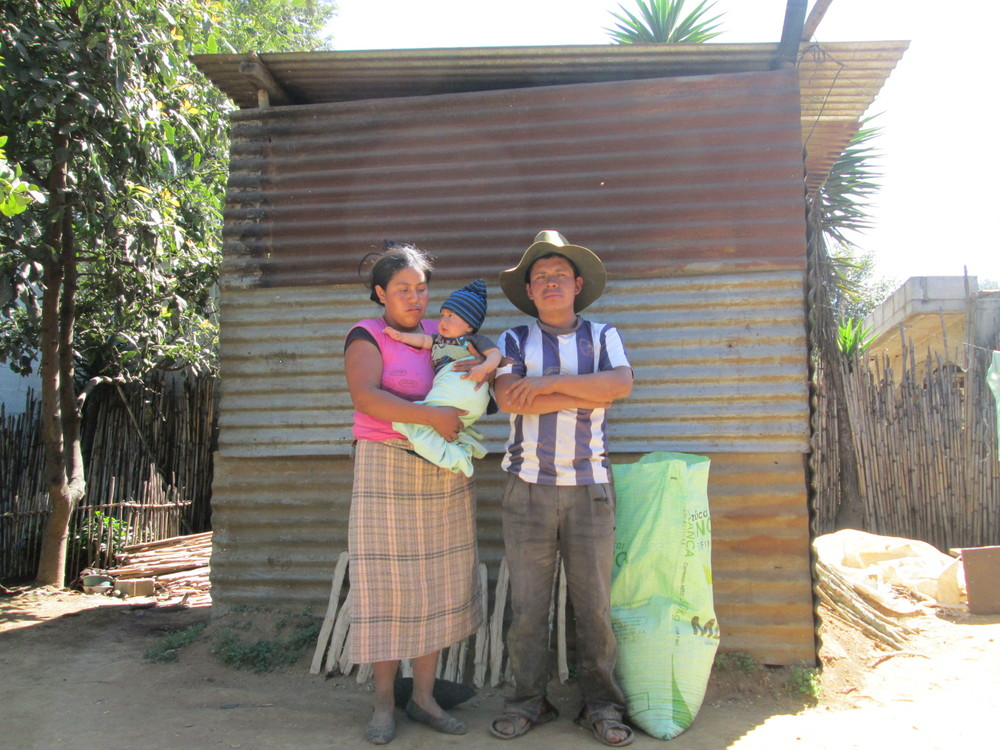 Family in front of previous shelter