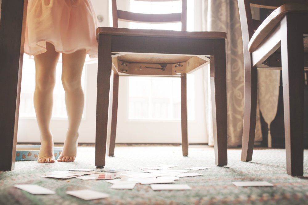 My kids love to play board games...but they don't like cleaning up. So here I am...cleaning up...under the kitchen table...and I'm just thinking about how she won't need to stand on her tiptoes for long.