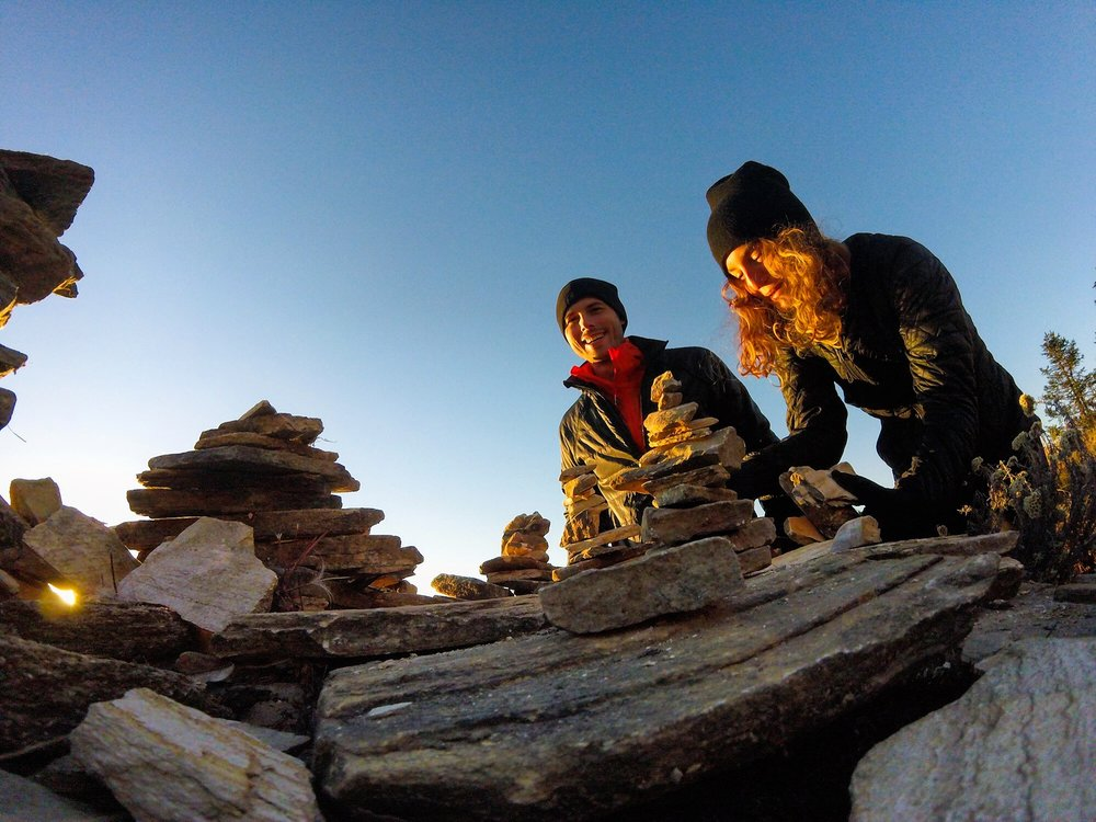 Nov 9.3, 2016   We decide to leave our imprint by constructing a stone cairn above all the rest on this small monument ledge. Stacking rocks is an ancient human practice, often marking burial or ceremonial sites. Here we stack them for good luck, homage to the Mountain Spirit, but it's thought that they may also have been used for keeping the dead from rising when atop a relic stupa.
