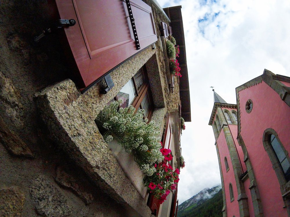 Day 2:   Trient, Valais   Swiss geography but French nevertheless, Trient is a most wonderful small village in a valley (Vallée du Trient). The skyline is capped by a perfectly pink chapel and rustic homes with flowers bursting open shutters of rouge.