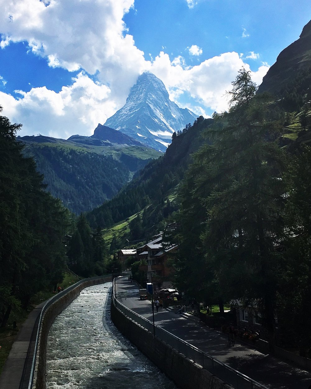 Day 7:   Zermatt, Switzerland   The Matterhorn stands far beyond the Vispa River. In German, 'Matte' translates to 'meadow' and so it is a meadowed-peak. Named after its approach, not so much it's climb, it represents the northeast precipice of this alpine adventure.