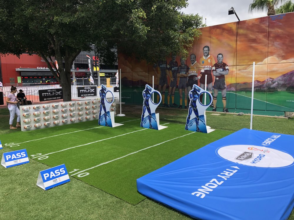 SCHICK Ball Pass - We created a mini footy field complete with Schick Hydro robot players. Participants had to pass the ball through the target 3 times and then score a dive try. It was a dynamic and highly engaging experiential space outside the RLWC final at Suncorp Stadium.