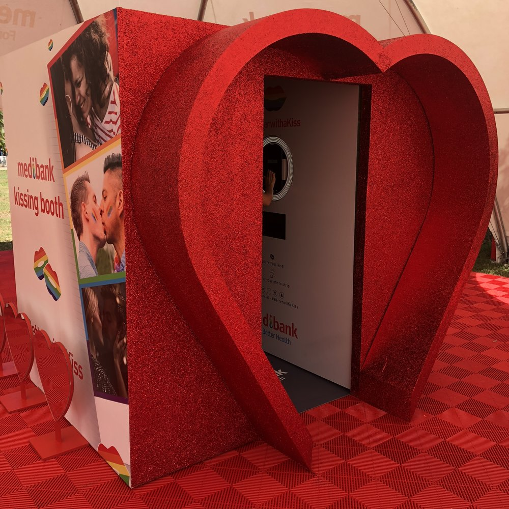 MEDIBANK Kissing Booth - There was no missing this Medibank Kissing Booth. It was a giant red-glitter love-heart kissing booth in the name of Mardi Gras. Complete with make up artists at the 'love-bar' and TV screens on the outside showcasing the kisses going on inside. It sure did draw a crowd, and we weren't surprised as with the amount of red glitter we used, this was about as loud & proud as it gets.
