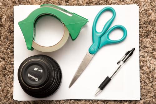 Paper, tape, pen, paper weight, scissors