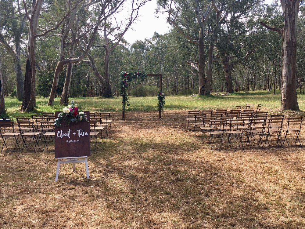 SIMPLE & SWEET    Inclusions:    40 x French Bistro Folding Chairs    1 x Wooden Arbour    1 x Signing Table and 2 chairs    1 x Jute Rug    1 x Welcome Sign by Mumma Goose    1 x Easel for Signage    Delivery, Set up, Pack Down and Clean up of site included.    PRICE: $900