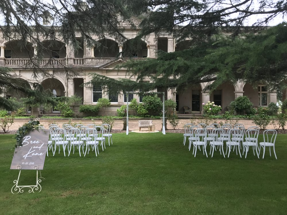 White Wedding Ceremony:      Inclusions:    30 x White Bentwood Chairs    1 x White Arbour    1 x Custom Designed Sign by Murphy & Co    1 x Easel for Signage    1 x Jute Rug    1 x Signing Table and French Provincial Chair      Set Up, Pack Down and Clean Up of Site      $800.00 *Not including delivery