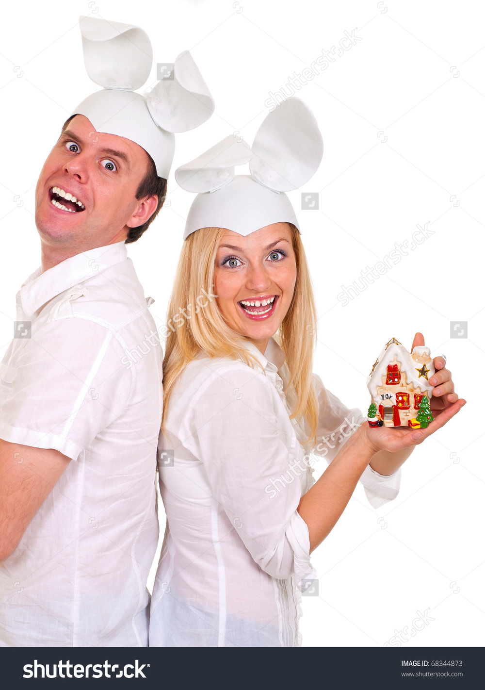 Title: Funny young couple wearing rabbit hats Seems like a perfectly normal couple.