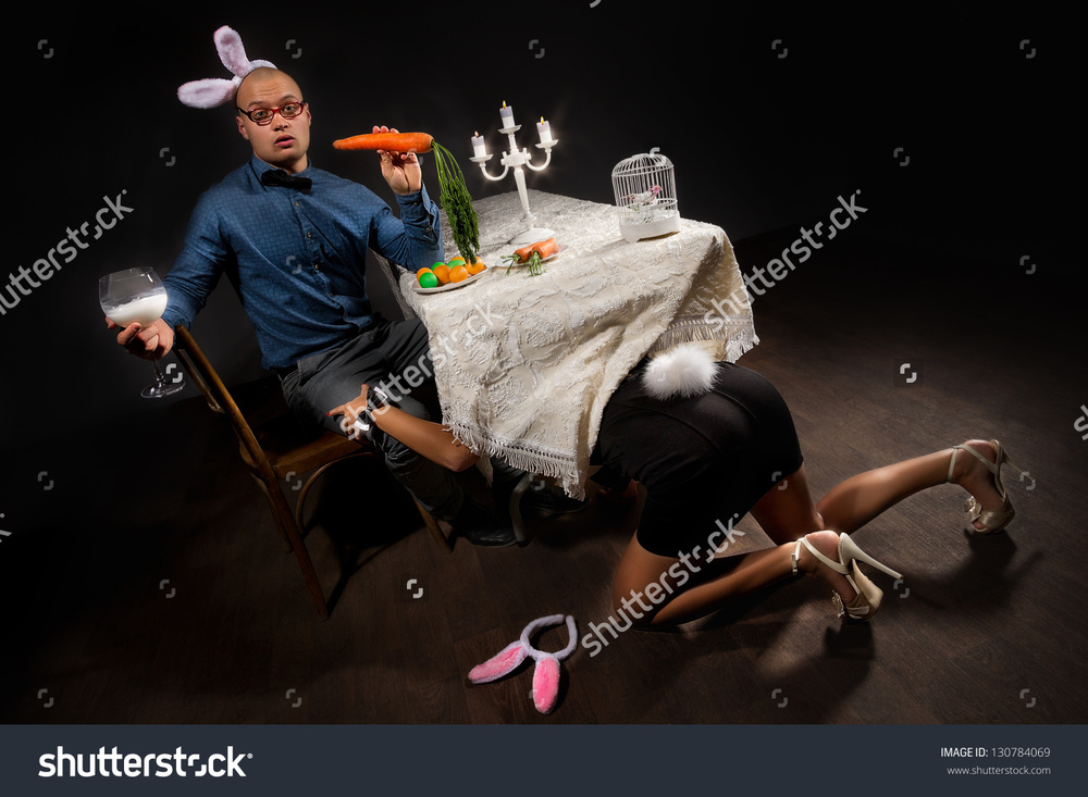 Title: Lovely woman in rabbit costume is seducing her boyfriend bunny under table That's a long title, anyways this might be used for that kinky restaurant around the corner.