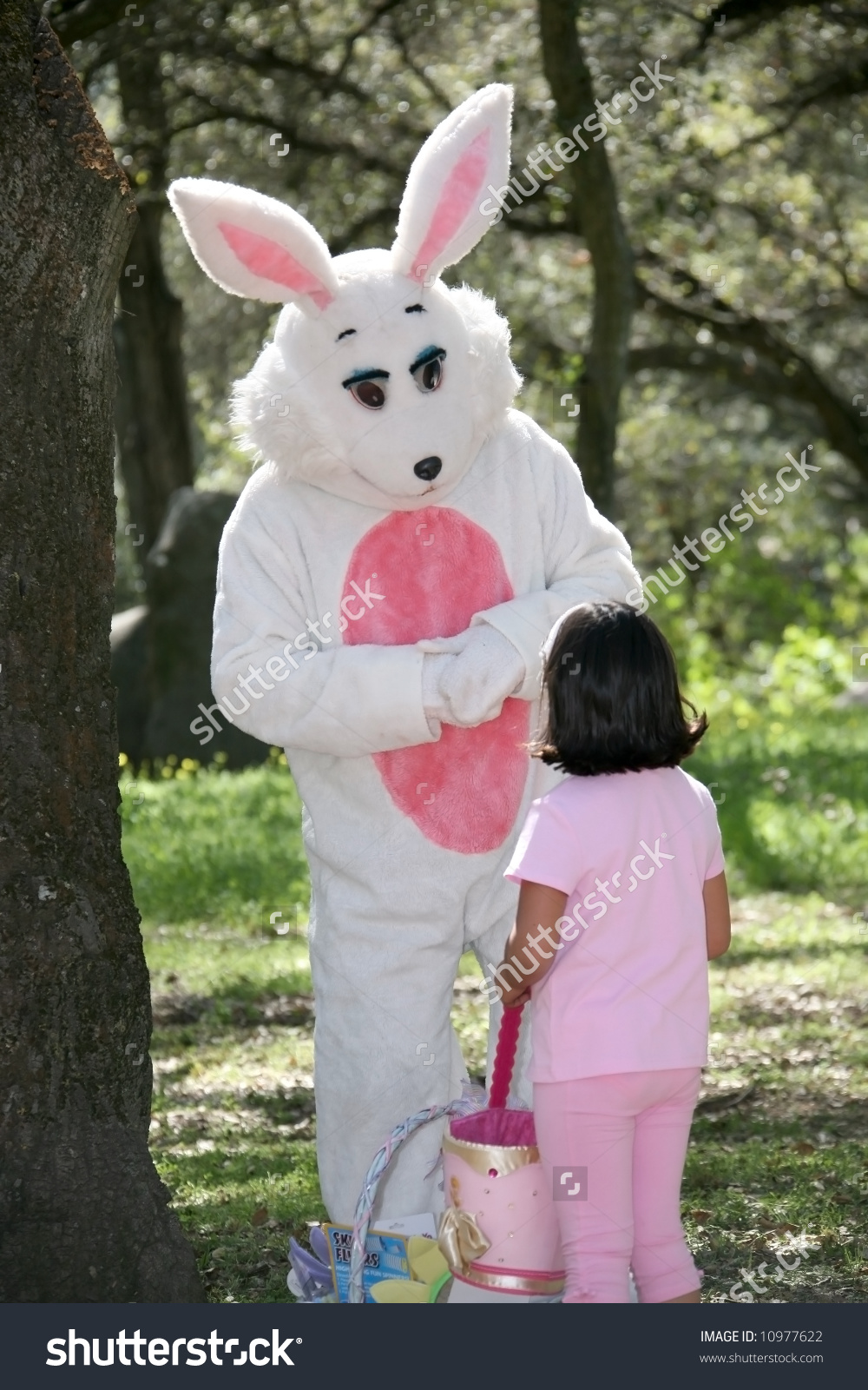 Title: Man in a easter bunny costume with a little girl I feel very uncomfortable with this photo. This guy should be arrested.