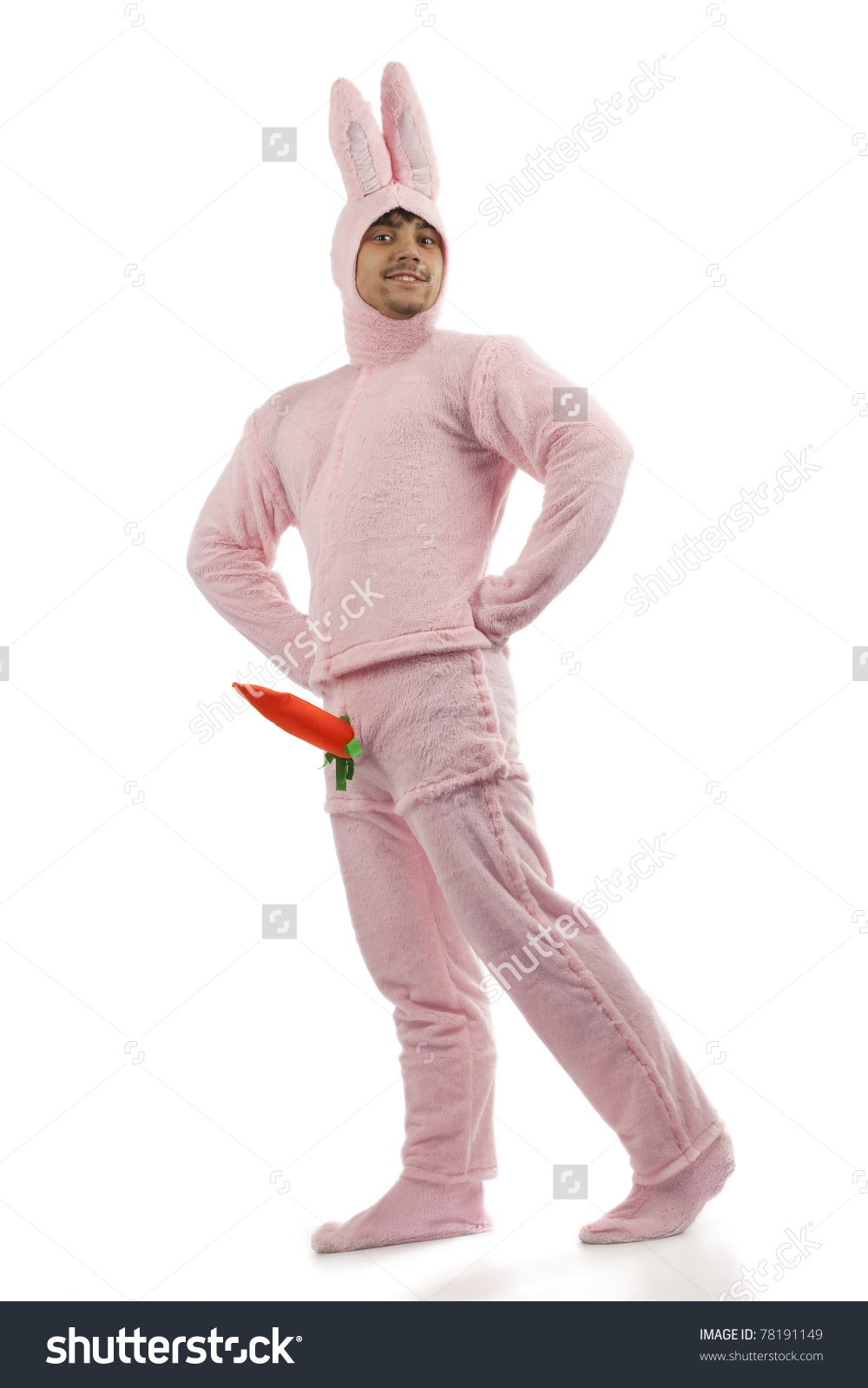 Title: Portrait of cheerful pink rabbit is proud of his carrot isolated on white background Are you hungry or just happy to see me?