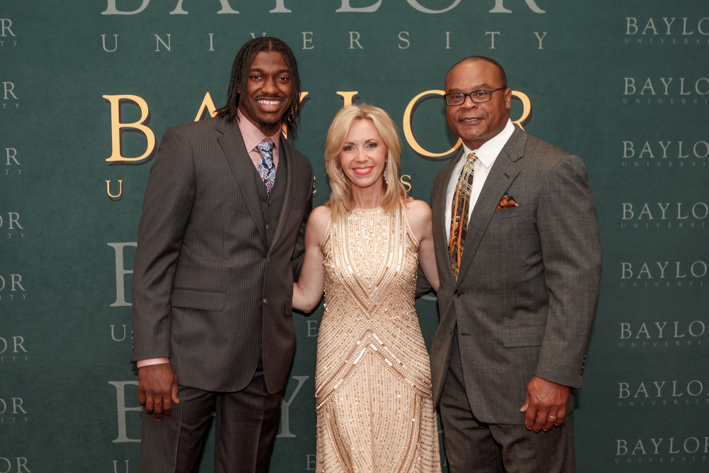 Carson with Heisman winner & NFL QB Robert Griffin III (on left) and Pro Football Hall of Famer Mike Singletary (right)