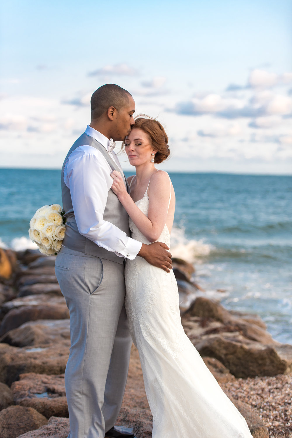 bride and groom portraits in cape cod in front of ocean