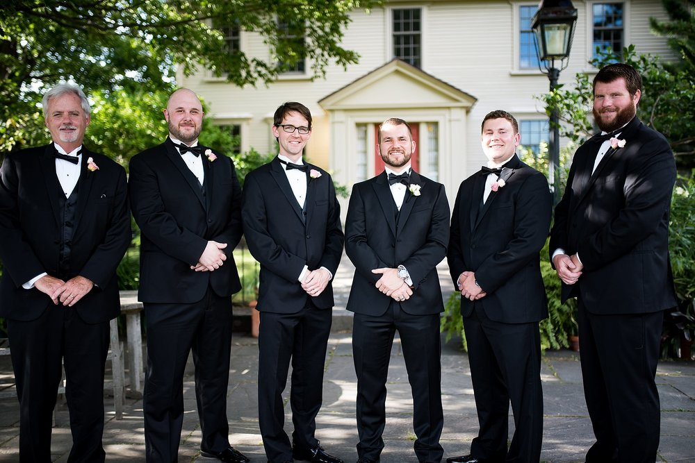 groomsmen pose for pictures at tower hill botanic garden