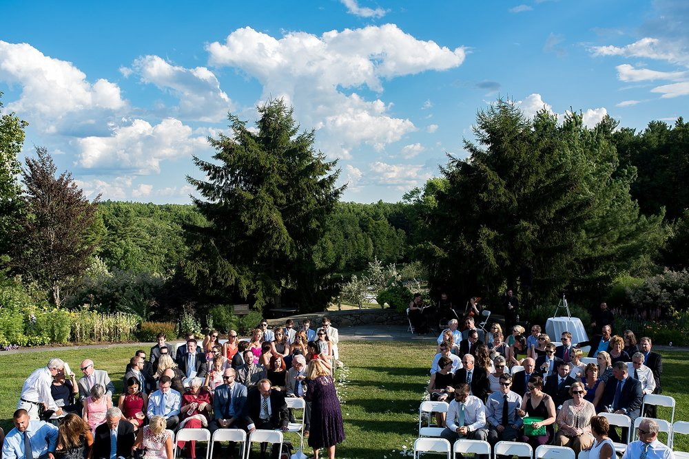 a scenic view of an outdoor ceremony at tower hill botanic garden