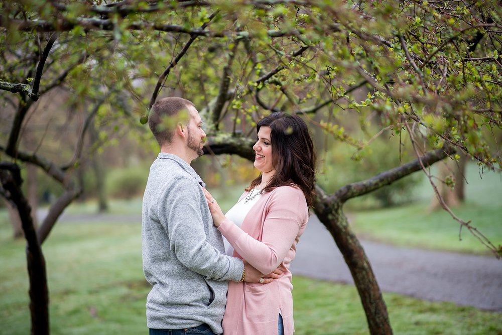 happy couple in larz anderson park