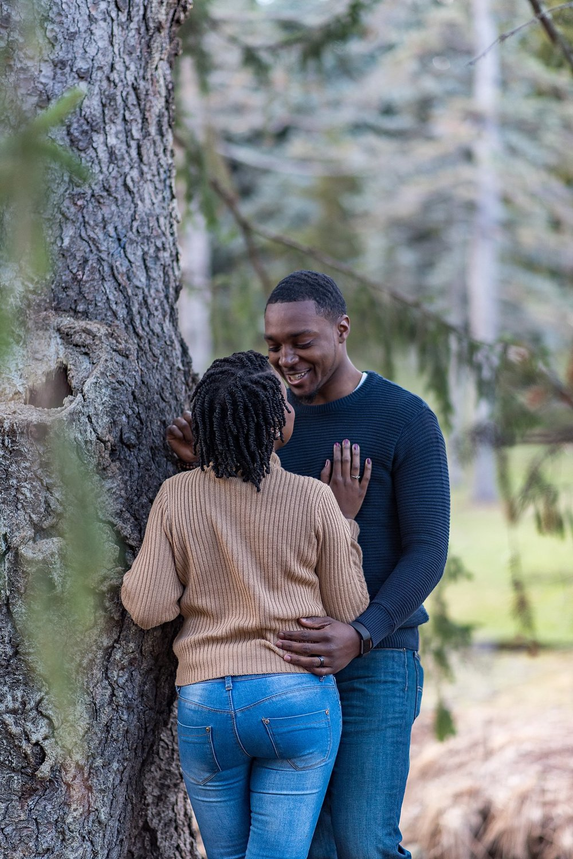 Couple standing under tree at Arnold Arboretum