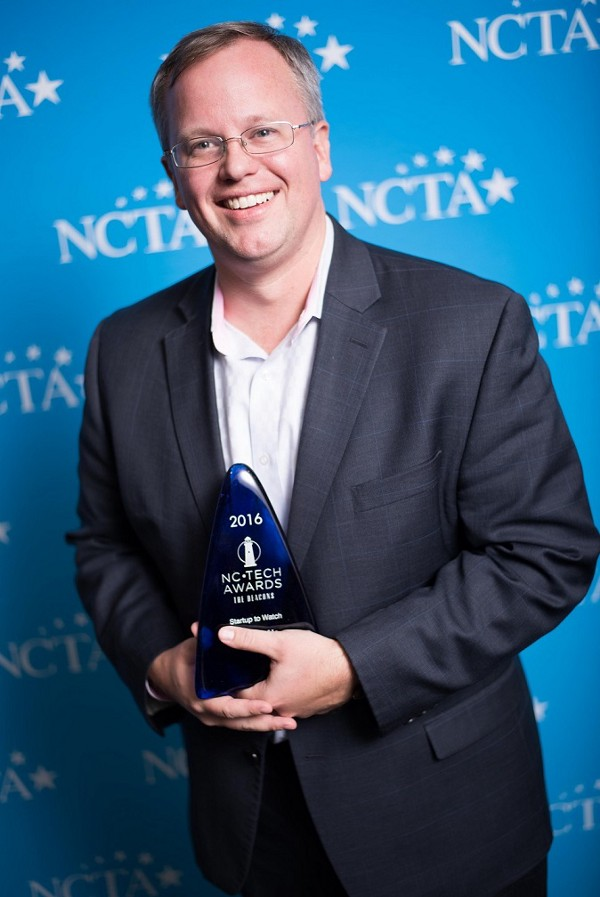 Lea(R)n CEO and co-founder,  Karl Rectanus , accepts the beacon as one of the 2016 Top 10 Startup to Watch at the NC Tech Awards.