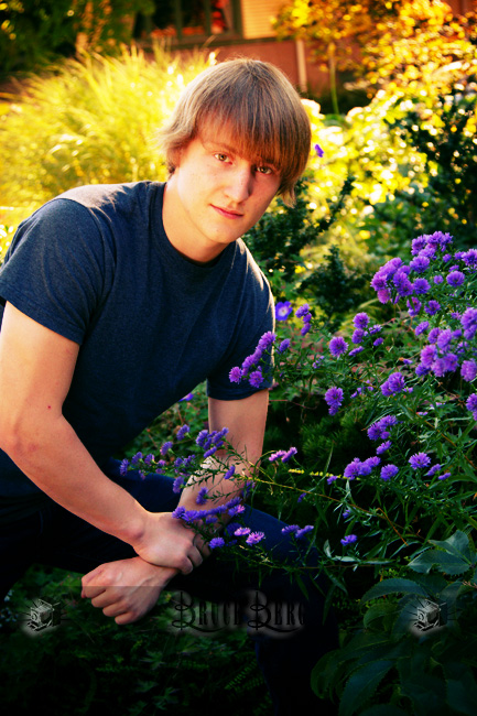 young teenager man boy outside by flowers