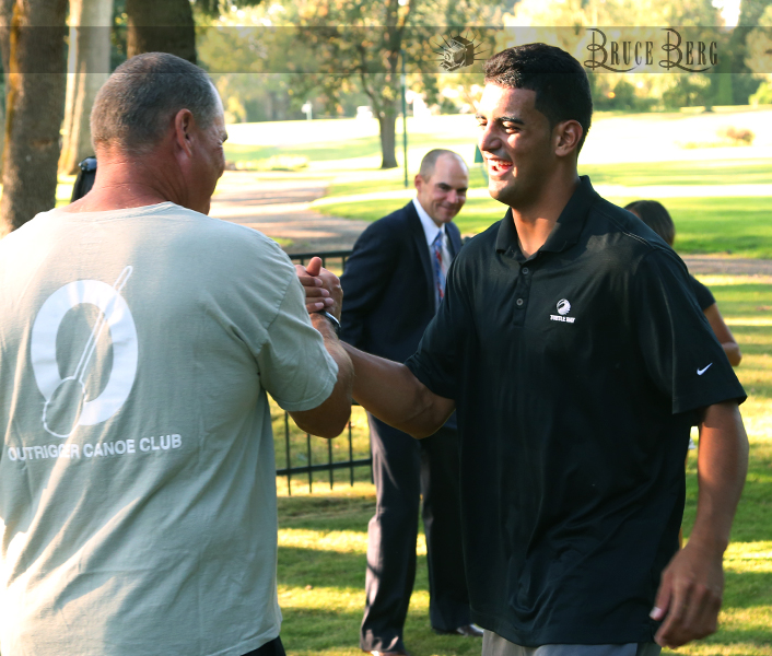 Coach Greatwood during the reception getting kudos from Marcus Mariota.