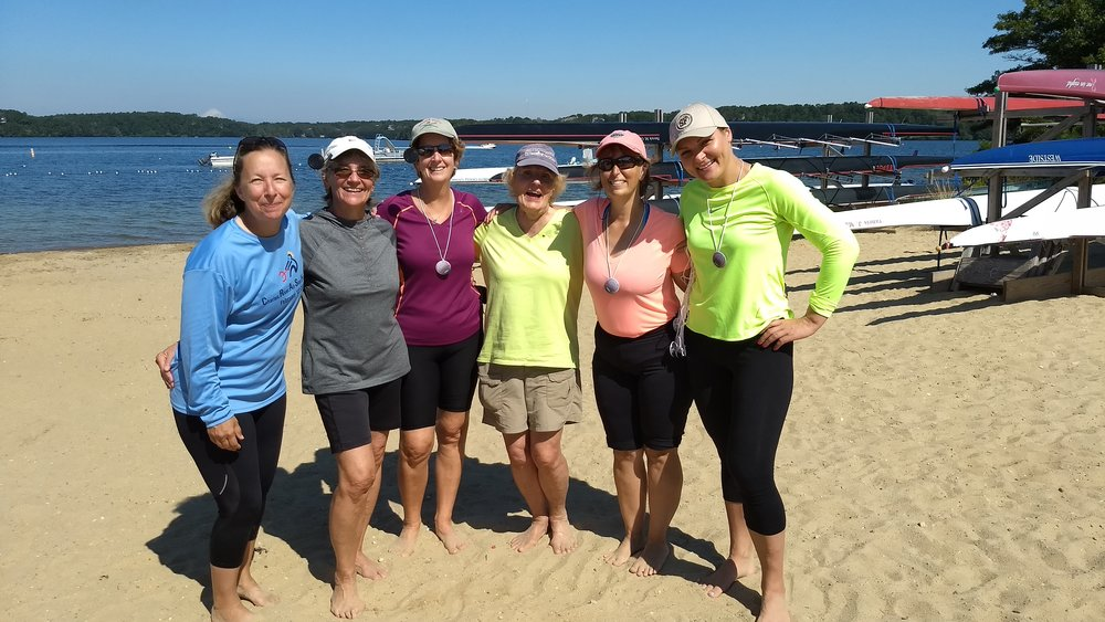 Coach Howard (center) keeps things fun on the water and on the beach.
