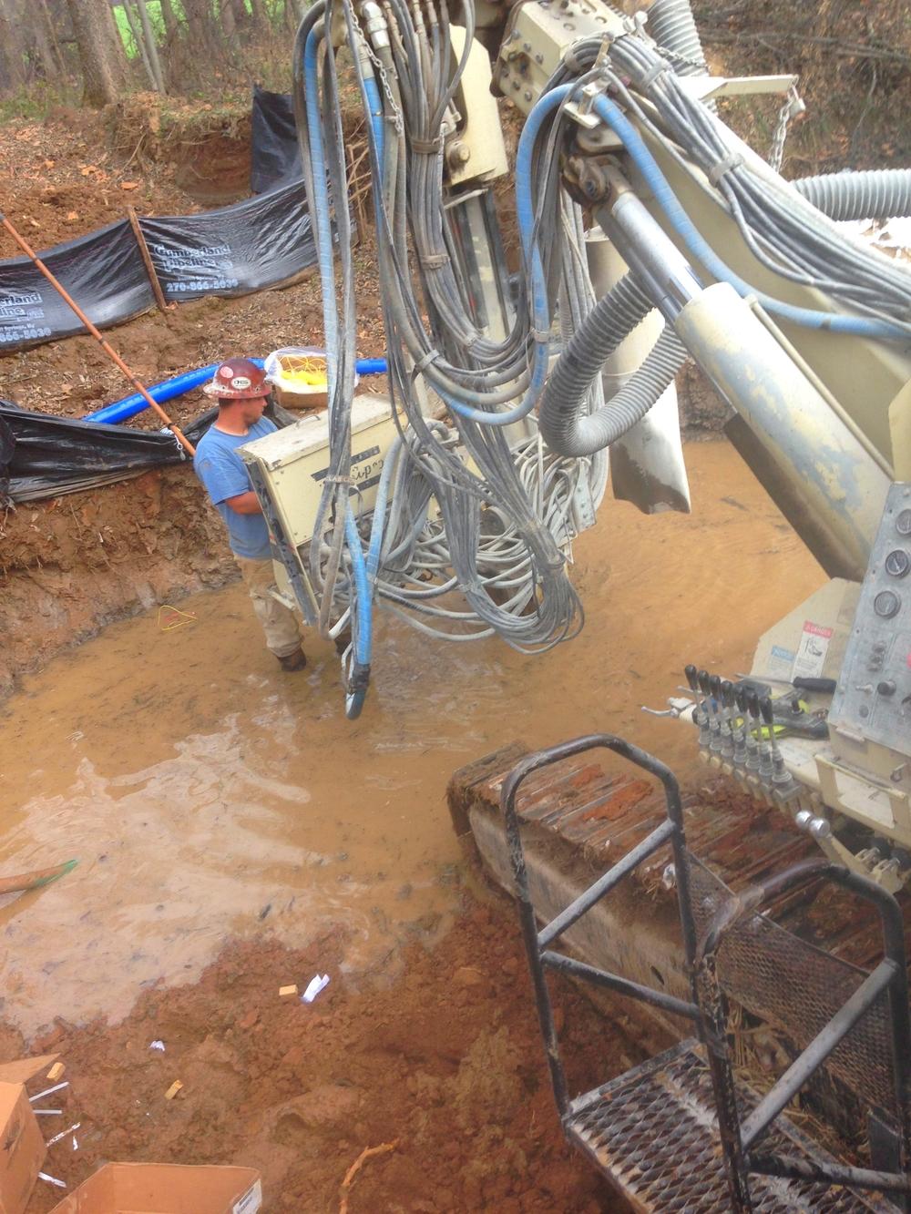 Stephen Drilling in Water.JPG