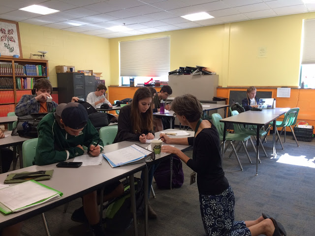 Math teacher Whitney Machnik helps students during Solon Block (Image courtesy Solon Salutes)