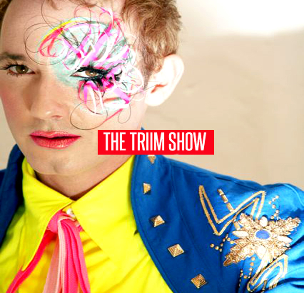 """Photograph by Karl Giant. Art Direction and design StormCo Creative.  2006- THE TRIIM SHOW was a Rock / Rap / Pop project Storm created with French DJ / Producer Lone and Supermodel / Rapper Triim. Outrageous explicit lyrics and colorful free spirited performances made THE TRIIM SHOW somewhat of cult band in Los Angeles in the mid 2000's. Compared to NYC legends """" Dee-Lite"""" and the """" The B52's"""" THE TRIIM SHOW brought a playful sexuality to the streets with Hip Hop loops and dangerously catchy pop songs. They headlined Gay Pride Toronto, Los Angeles and Las Vegas promoting their debut ( and only ) record """" TRIIM SHOW SAVES THE GALAXY """" then disbanded dues to an incident at the Roosevelt hotel in Hollywood involving a steak knife, a bottle of Vodka and a white leather couch.Long before Nicki Minaj there was the Triim Show. Part theater, part discotheque ALL FUN!.  STAND OUT TRACKS : """"Fingerbang"""" """" Gay Boy Hooker"""" """"Drag me Up"""" & """" Disco Junkie"""" and Storm's rap debut on """" Girlz & Boys"""""""