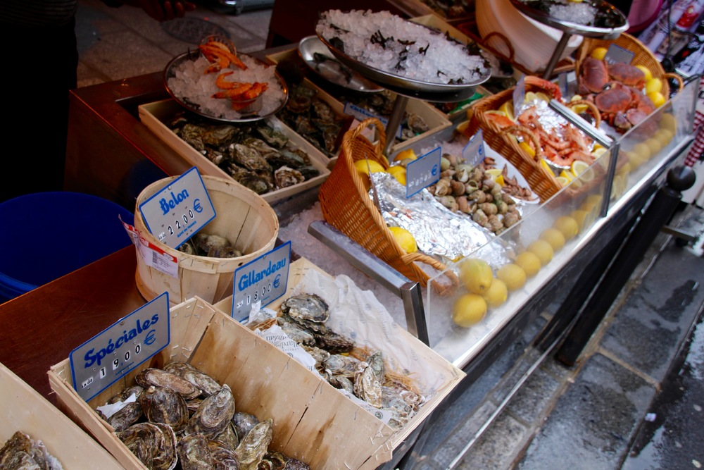 Oysters, prawns, crabs and snails are all beautifully displayed to tempt hungry Parisian passerby.